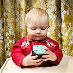 Baby with Cupcake    Stock Photo - Premium Rights-Managed, Artist: Brian Kuhlmann, Code: 700-02693924
