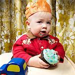Baby Eating Cupcake    Stock Photo - Premium Rights-Managed, Artist: Brian Kuhlmann, Code: 700-02693925