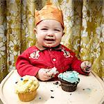 Baby Eating Cupcakes    Stock Photo - Premium Rights-Managed, Artist: Brian Kuhlmann, Code: 700-02693927