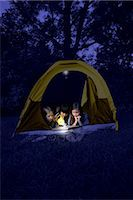 Girls in Tent at Night, Using Flashlight to Read Magazine    Stock Photo - Premium Rights-Managednull, Code: 700-02698404