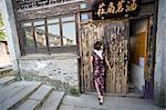 Woman Standing Outside of Building in Suzhou, China
