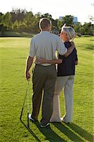 Couple on Golf Course, Burlington, Ontario, Canada    Stock Photo - Premium Royalty-Freenull, Code: 600-02701108