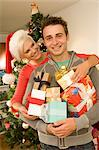 Portrait of Couple Holding Christmas Gifts    Stock Photo - Premium Rights-Managed, Artist: Raoul Minsart, Code: 700-02702521