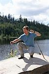 Man Catching Fish, Norway    Stock Photo - Premium Rights-Managed, Artist: Anders Hald, Code: 700-02702603
