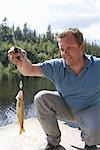 Man Catching Fish, Norway    Stock Photo - Premium Rights-Managed, Artist: Anders Hald, Code: 700-02702604