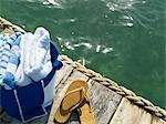 Towels and Shoes on a Dock by the Ocean, Belize