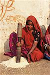 Woman pounding food in village near Deogarh, Rajasthan state, India, Asia    Stock Photo - Premium Rights-Managed, Artist: Robert Harding Images, Code: 841-02703291