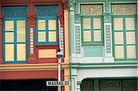 Close-up of old houses with shuttered windows and pilasters with decorative mouldings, and sign for Madras Street in Little India, Singapore, Southeast Asia, Asia    Stock Photo - Premium Rights-Managednull, Code: 841-02704423