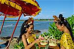 Two women prepare an offering to the sea at Jimbaran Beach on the island of Bali, Indonesia, Southeast Asia, Asia    Stock Photo - Premium Rights-Managed, Artist: Robert Harding Images, Code: 841-02705299