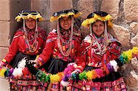 south american woman - Portrait of three smiling local Peruvian girls in traditional dance dress, smiling and looking at the camera, Cuzco, Peru, South America    Stock Photo - Premium Rights-Managednull, Code: 841-02705655