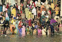 Hindus bathing in the early mornin in the holy river Ganges (Ganga) along Dasaswamedh Ghat, Varanasi (Benares), Uttar Pradesh state, India, Asia    Stock Photo - Premium Rights-Managednull, Code: 841-02705785