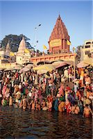 Hindus bathing in the early morning in the holy river Ganges (Ganga) along Dasaswamedh Ghat, Varanasi (Benares), Uttar Pradesh state, India, Asia    Stock Photo - Premium Rights-Managednull, Code: 841-02705786