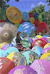 Woman painting umbrellas, Bo Sang umbrella village, Chiang Mai, northern Thailand, Asia