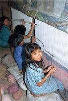 Portrait of child labourer in carpet factory, Bhaktapur, Kathmandu Valley, Nepal, Asia    Stock Photo - Premium Rights-Managednull, Code: 841-02706781