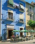 Pavement cafe in front of a blue painted building in Villajoyosa, Valencia, Spain, Europe    Stock Photo - Premium Rights-Managed, Artist: Robert Harding Images, Code: 841-02707087