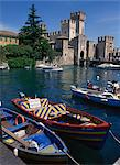 Moored boats in the harbour at Sirmione on Lake Garda, Lombardia, Italy, Europe