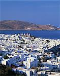 White houses and windmills, with the sea and hills in the background, on Mykonos, Cyclades Islands, Greek Islands, Greece, Europe