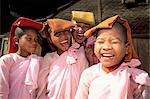 Portrait of four mischievous nuns, Meiktila, Myanmar (Burma), Asia