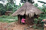 Little girl dressed for church, in front of hut, Uganda, East Africa, Africa