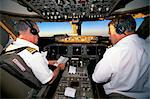 Pilots on flight deck of Jumbo Boeing 747 of Air New Zealand with sunrise ahead    Stock Photo - Premium Rights-Managed, Artist: Robert Harding Images, Code: 841-02711663