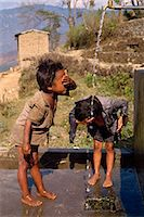 Portrait of two children washing at the school funded by Save the Children, at Chataura, Nepal, Asia    Stock Photo - Premium Rights-Managednull, Code: 841-02711995