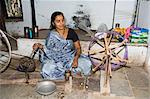 A woman spinning at one of the cooperatives in an area that is famous for its saris, Maheshwar, Madhya Pradesh state, India, Asia    Stock Photo - Premium Rights-Managed, Artist: Robert Harding Images, Code: 841-02712339