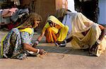 Women painting a mandana on the ground, village near Jodhpur, Rajasthan state, India, Asia    Stock Photo - Premium Rights-Managed, Artist: Robert Harding Images, Code: 841-02714204