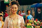 Portrait of a young Thai 'queen' holding flowers competing for 'Flower Festival Queen' title, Chiang Mai, Thailand    Stock Photo - Premium Rights-Managed, Artist: Robert Harding Images, Code: 841-02714823