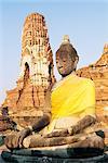 Sitting Buddha statue and chedi (pagoda) (stupa) at Buddhist temple of Wat Phra Mahathat, dating from 1300 AD, Ayuthaya (Ayutthaya), Thailand, Southeast Asia, Asia