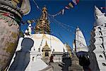 A monk walks clockwise around the buddhist stupa called Swayambhu or Swayambhunath, Kathmandu, Nepal    Stock Photo - Premium Rights-Managed, Artist: Robert Harding Images, Code: 841-02718674