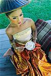Girl in traditional Thai clothes eating rice, Phuket, Thailand, Southeast Asia, Asia    Stock Photo - Premium Rights-Managed, Artist: Robert Harding Images, Code: 841-02720101