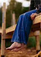 Girl Sitting on the Edge of a Wooden Dock at Sunset    Stock Photo - Premium Rights-Managednull, Code: 700-02723074