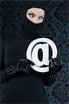 Woman Dressed in Black Holding @ Symbol    Stock Photo - Premium Rights-Managed, Artist: Apolonia, Code: 700-02724733