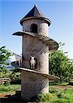 Goat House, cylindrical building with spiral ramp for goats, with goat in view. Cape Town Region.    Stock Photo - Premium Rights-Managed, Artist: Arcaid, Code: 845-02729322