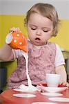 Young girl spilling milk on table Stock Photo - Premium Royalty-Free, Artist: Westend61, Code: 649-02732509