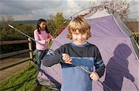 Boy and girl putting up tent Stock Photo - Premium Royalty-Freenull, Code: 649-02733239