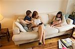 Children in Living Room Playing Video Games    Stock Photo - Premium Rights-Managed, Artist: Bruce Fleming, Code: 700-02738491