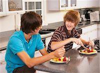 Boys Eating Breakfast    Stock Photo - Premium Rights-Managednull, Code: 700-02738784