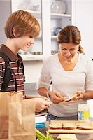 Mother Making School Lunch for Son    Stock Photo - Premium Rights-Managednull, Code: 700-02738794
