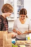Mother Making School Lunch for Son    Stock Photo - Premium Rights-Managed, Artist: SimplyMui, Code: 700-02738794
