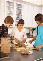 Mother Making School Lunches for Sons    Stock Photo - Premium Rights-Managednull, Code: 700-02738796
