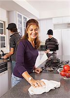Mother and Sons Cleaning the Kitchen    Stock Photo - Premium Rights-Managednull, Code: 700-02738810