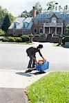 Teenager Taking the Recycling Box to the Curb    Stock Photo - Premium Rights-Managed, Artist: SimplyMui, Code: 700-02738813