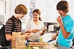 Mother Making School Lunches for Sons    Stock Photo - Premium Rights-Managed, Artist: SimplyMui, Code: 700-02738843