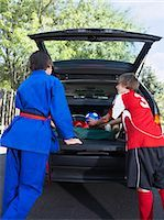 Boys in Karate and Soccer Uniforms Packing the Car    Stock Photo - Premium Rights-Managednull, Code: 700-02738846
