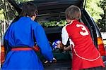 Boys in Karate and Soccer Uniforms Packing the Car    Stock Photo - Premium Rights-Managed, Artist: SimplyMui, Code: 700-02738847
