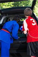 Boys in Karate and Soccer Uniforms Packing the Car    Stock Photo - Premium Rights-Managednull, Code: 700-02738848