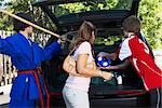 Boys in Karate and Soccer Uniforms Helping Mom Pack the Car    Stock Photo - Premium Rights-Managed, Artist: SimplyMui, Code: 700-02738849