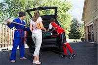 Boys in Karate and Soccer Uniforms Helping Mom Pack the Car    Stock Photo - Premium Rights-Managednull, Code: 700-02738850