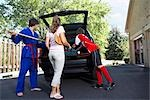 Boys in Karate and Soccer Uniforms Helping Mom Pack the Car    Stock Photo - Premium Rights-Managed, Artist: SimplyMui, Code: 700-02738850